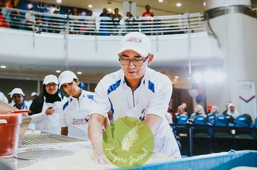 Champion Abdillah Abdul Shukor, showcasing his pizza making skills