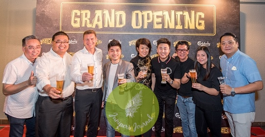 Group photo of the founders of Tap It Out Solaris and the Carlsberg Malaysia team. L-R: Michael Liow, Gary Tan, Lars Lehmann, Ethan Yoon, Pearl Lai, Ryan Foo, Joltan Ng, Eleen Ooi and Sherman Tan
