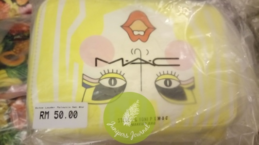 Only 2 of these yellow pouches left (s0 cute!) at MAC
