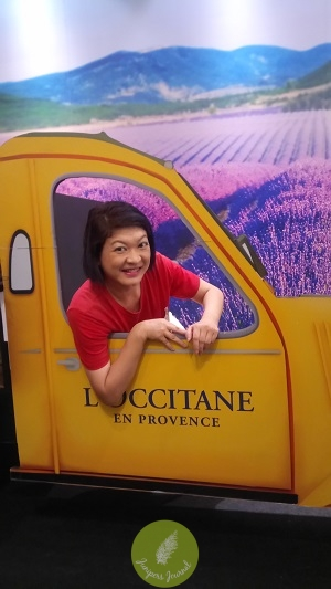 In the L'Occitane van driving through fields of lavender