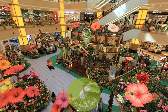 The Sunway Pyramid Mall is decorated in floral arrangements where shoppers can immerse in a journey through the unique indoor garden with five different activities, each representing a petal of a bunga raya