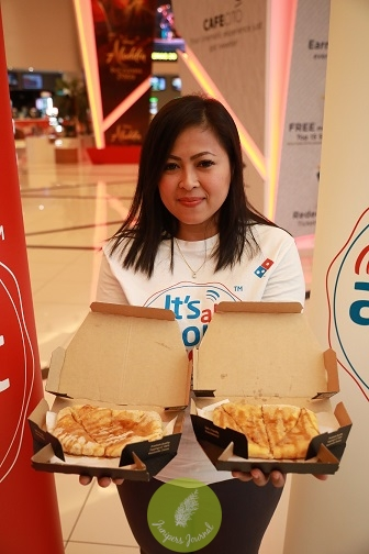 Linda Hassan, Senior Vice President of Marketing Domino's Pizza Malaysia and Singapore holding the Saranghae-ny Stix