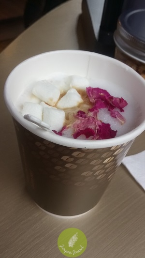 White coffee Nescafe Gold with toppings of rose petals and marshmallows