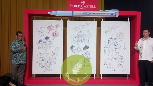 Datuk Lat unveils his creations using Faber-Castell Grip X with Managing Director of A.W. Faber-Castell (M) Sdn Bhd, Mr. Andrew Woon