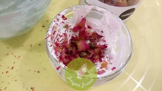 Sprinkle rose buds into mixture