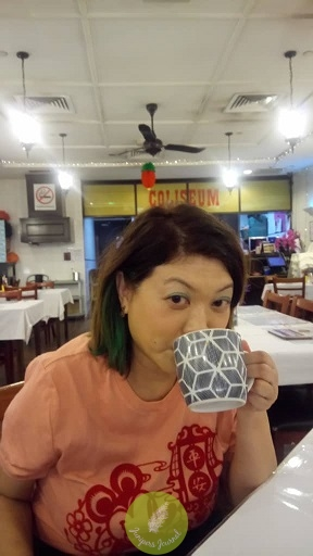Sipping on teh tarik while waiting for omelet set