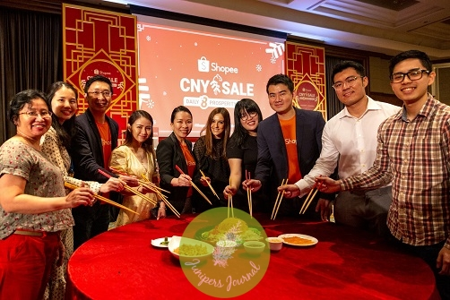 Shino Lee, Marketing Lead (Communications) (fifth from left), Shopee Malaysia, members of the Shopee Malaysia management team together with brands and partners tossing the Yee Sang for a prosperous New Year at the Shopee CNY Sale launch, held at Mandarin Oriental, Kuala Lumpur