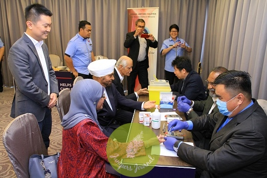 Dr. Fazilah Shaik Allaudin, Datuk Dr J.S. Sambhi and Dato Gurbakhash Singh get their cholesterol checked at the YJM-Quaker Smart Heart Challenge launch at Invito Hotel in Bangsar South, Kuala Lumpur, as PepsiCo Head of Sales Teh Boon Kiat looks on.