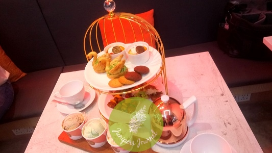 'Journey for Two' High Tea Set, with a choice ensemble of cold and hot hors d'oeuvres, sweet and savoury pastries, a flight of FROZEN famous ice cream, and a pot of premium TWG tea