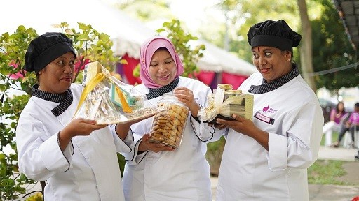 B40 women showcasing their handmade cookies