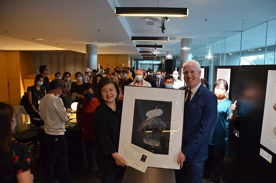 Sharon Kow presents one of her art pieces to Mr. Michael Hanratty, GM of G Hotel
