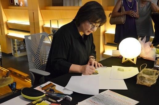 Sharon Kow uses colour pencils to draw
